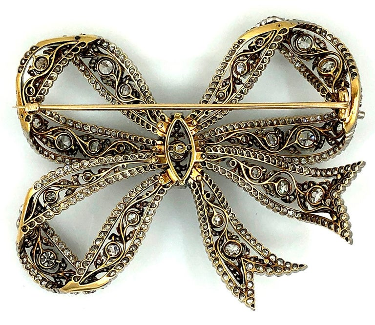 The delicate three-loop bow of openwork design set with 34 old European-cut diamonds weighing approx. 9.50 carats, accented by numerous smaller old European-cut diamonds weighing approximately 21.25 carats. Circa 1910