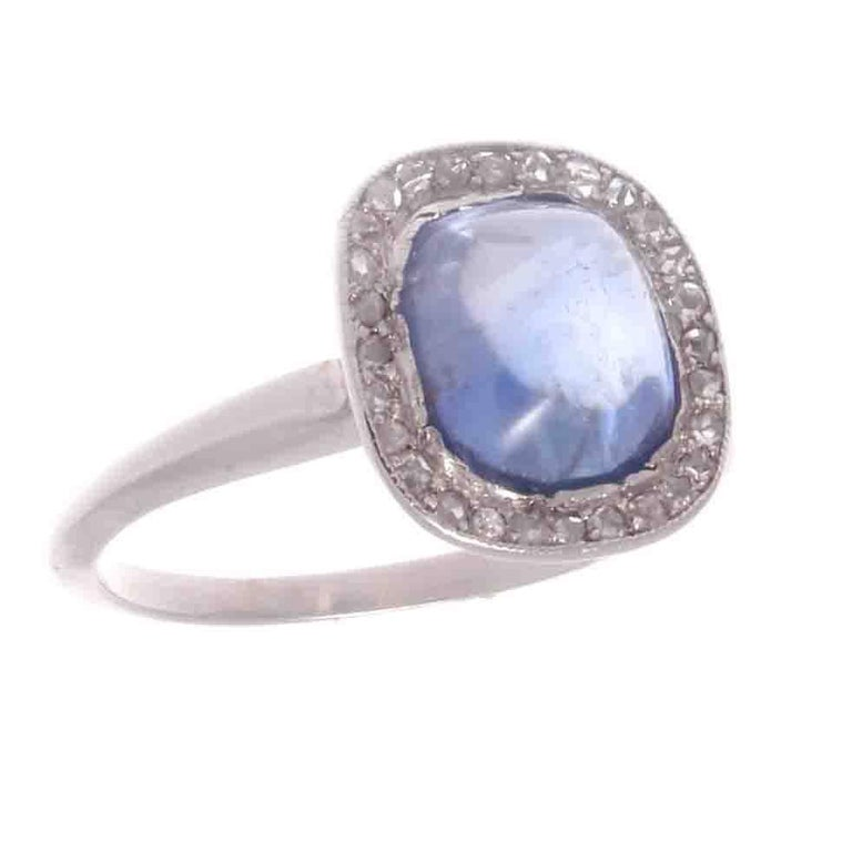 A delicate creation from the revolutionary period in jewelry. The then new technological discoveries advanced possibilities of jewelry design and craftsmanship. Featuring a lovely cornflower blue Ceylon sapphire that weighs approximately 4.70