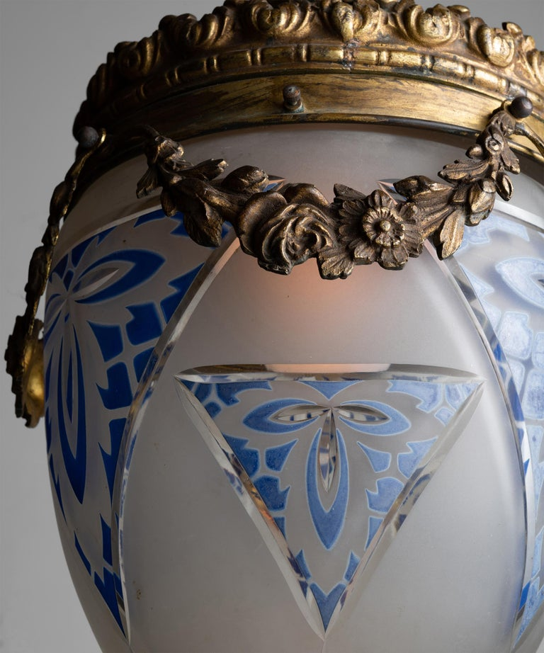 Edwardian cut glass pendant  England circa 1910  Gilt bronze metalwork with acid etched glass shade with stained blue motif.