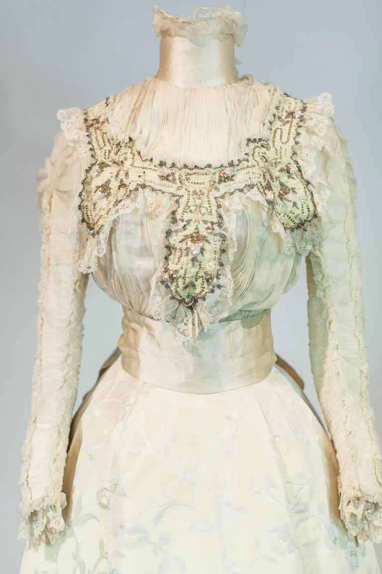 Circa 1895/1905 France   Two-part ceremony nuptial dress (?), skirt and bodice, Japanese style dating from the Belle Epoque. High-waisted corset with a label woven on the waistband indicating Mademoiselle Tessier St Etienne. Cream satin background