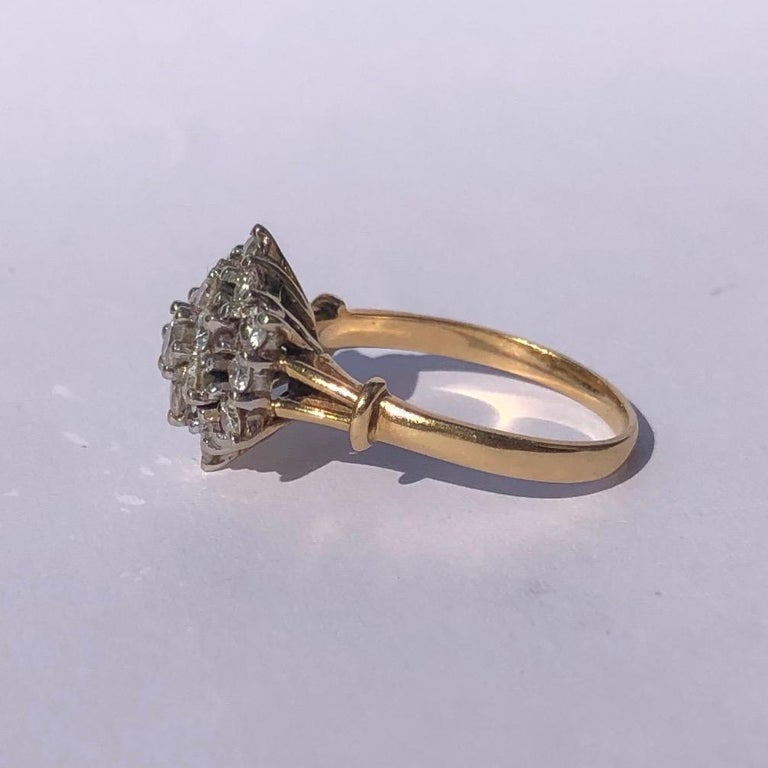 This cluster ring holds Diamonds totalling approx 1ct and are bright and sparkly. The stones are placed up high on an open work gallery, they are also set in platinum.   Ring Size: N or 6 3/4  Height From Finger: 8mm  Weight: 4.5g
