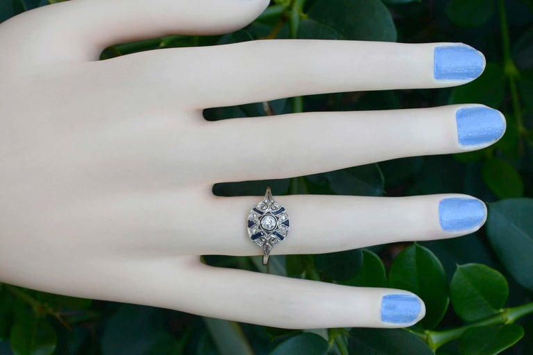 This stunning, delicate antique filigree ring, an original heirloom from the late 19th century oozes history and charm. Edwardian era jewelry is in great demand, and this dome style fits so nice and low on the hand and is accented with sapphires.