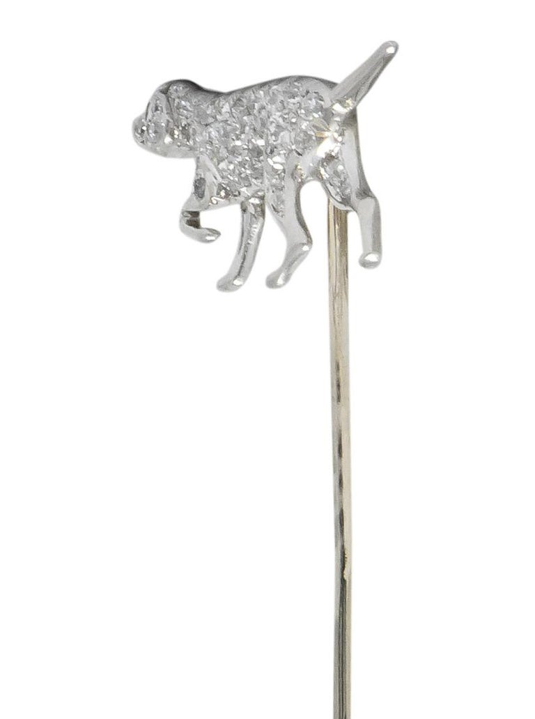 Designed as an English Pointer, in full point position  Pavé set with single cut diamonds, weighing approximately 0.50 carat total, eye-clean and white  With tiny round cut ruby eye  Tested as platinum with white gold pin stem  Dog Measures: 1/2 x 1