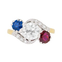 Edwardian Diamond, Sapphire and Ruby Three-Stone Twist Ring, circa 1910