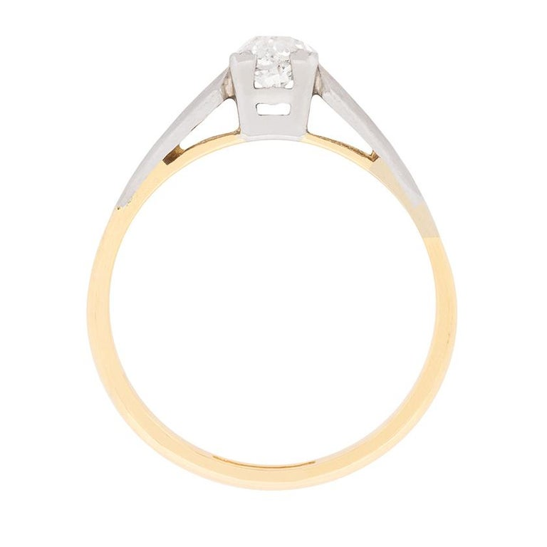 This simple and classic solitaire dates back to the Edwardian era. It features an old cut diamonds weighing 0.25 carat within a box setting made from platinum. It has been estimated as G in colour and VS2 in clarity. The shank has been made in 18