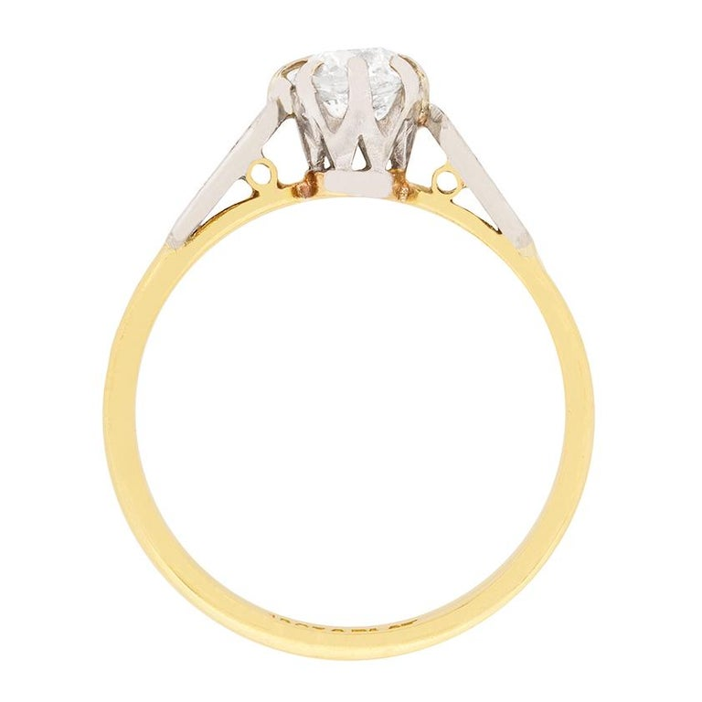 Dating to the Edwardian era, this solitaire features an old cushion cut as the centre of attention. It weighs 0.56 carat and has been estimated as H in colour and SI1 in clarity. The claw setting and patterned shoulders are made from platinum,