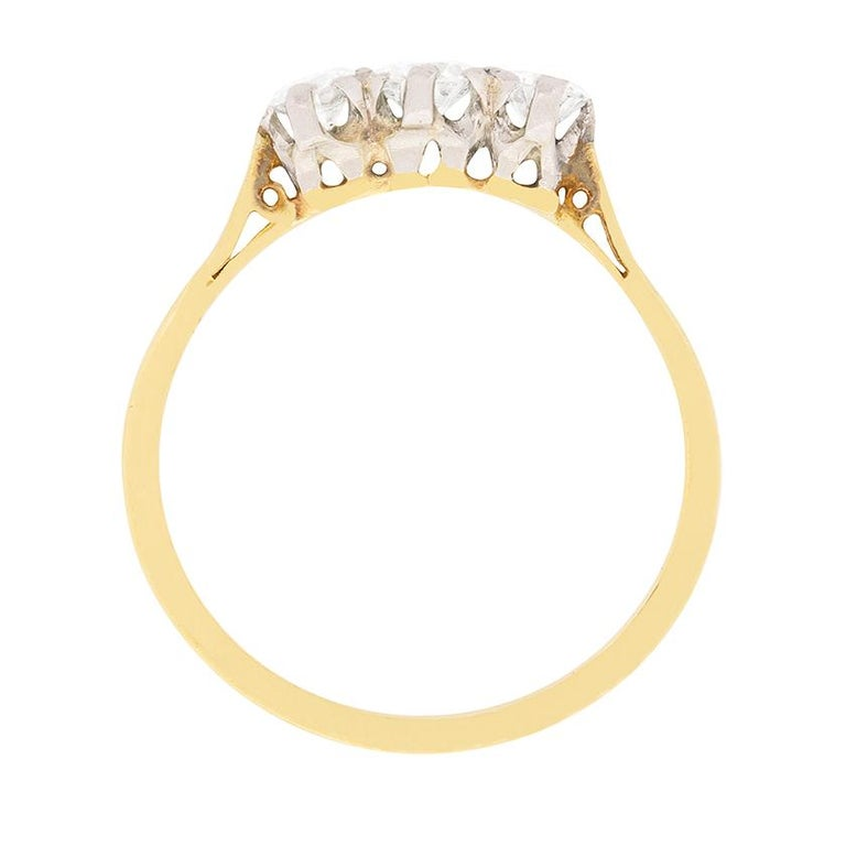 Dating to approximately 1910, this Edwardian three stone ring has a combined weight of 0.50 carat. The centre old cut diamond weighs 0.20 carat and the two supporting each 0.15 carat. They match in quality, H in colour and SI in clarity and are all