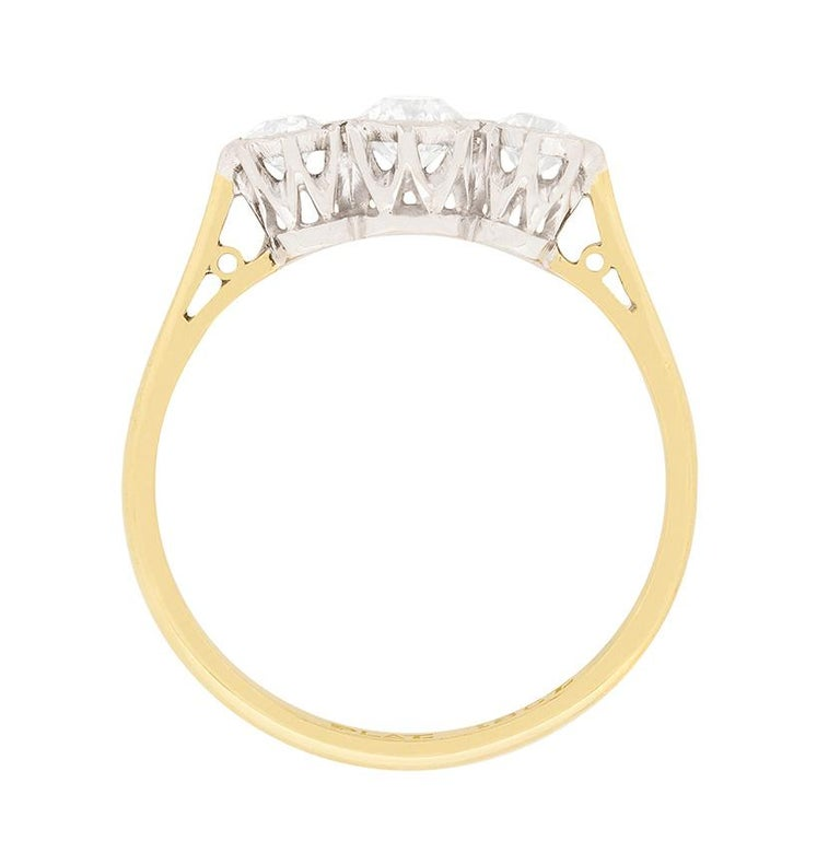 An elegant three stone ring dating back to the Edwardian era. The centre old cut diamond weighs 0.40 carat and the two set adjacent weigh 0.20 carat each. All match in quality, estimated as G in colour and VS and re set within an illusion setting.