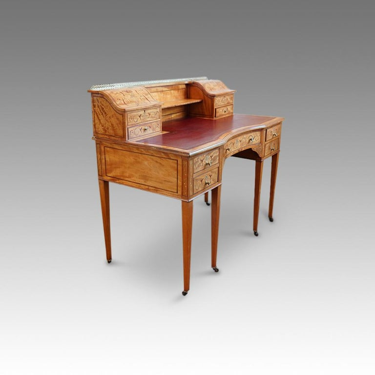 Edwardian inlaid satinwood desk Here we have this Edwardian desk made in inlaid satinwood, that was made in one of the finest workshops of the period. Imagine the exquisite English country home this would have been made for and the gentile life it