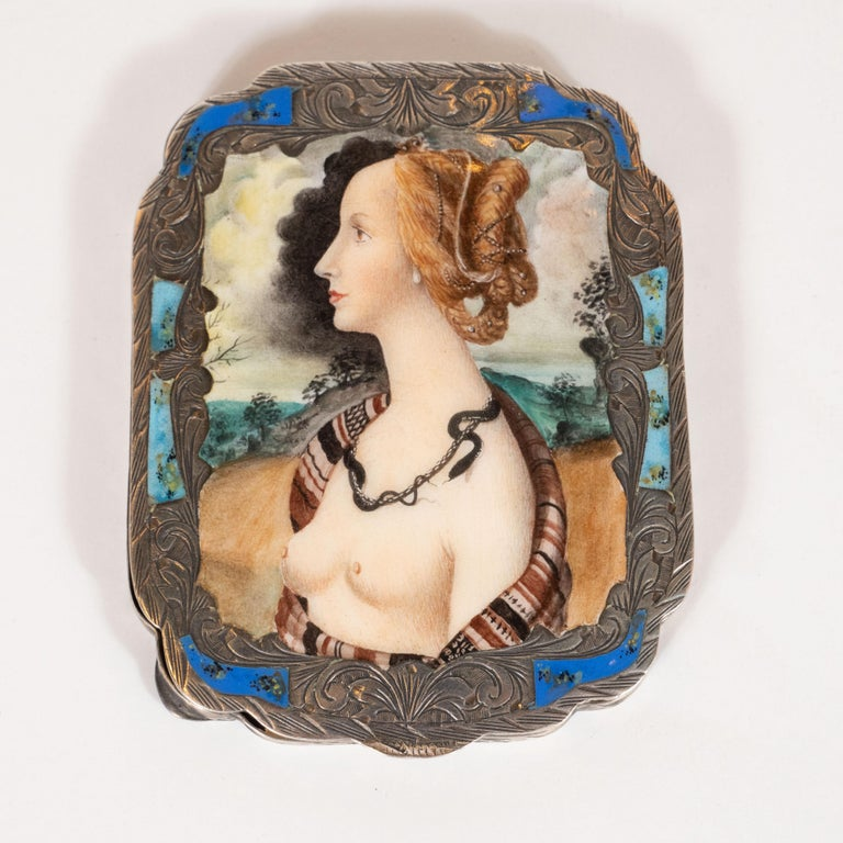 This elegant compact mirror was realized, by hand, in Florence, Italy, circa 1900. It features an octagonal body with an open compartment at the bottom- perfect as a tin for storing makeup, mints or any number of items- and a plain mirror inset into