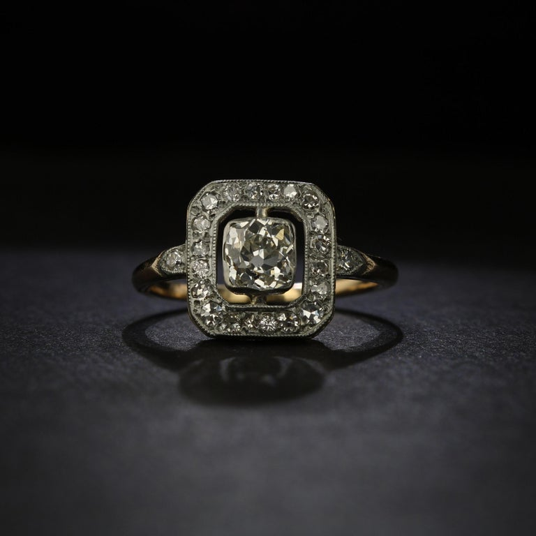 A striking piece from the Edwardian era, or the turn of the 20th century, this ring features a stunning 0.80 carat old mine cut diamond set preciously in a platinum bezel. Surrounding the diamond is an open and airy space that lets the beauty of the