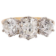 Edwardian Era Platinum and Gold Three-Stone Diamond Ring