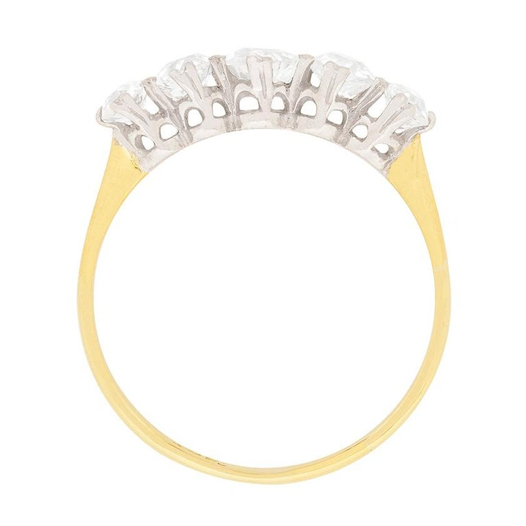 This beautiful, hand made ring, is a classic five stone. The diamonds are old cuts, which are hand cut stones. The centre weighs 0.50 carat and they graduate in size, 0.35 carat either side and 0.20 carat on each end. This brings the total to 1.60