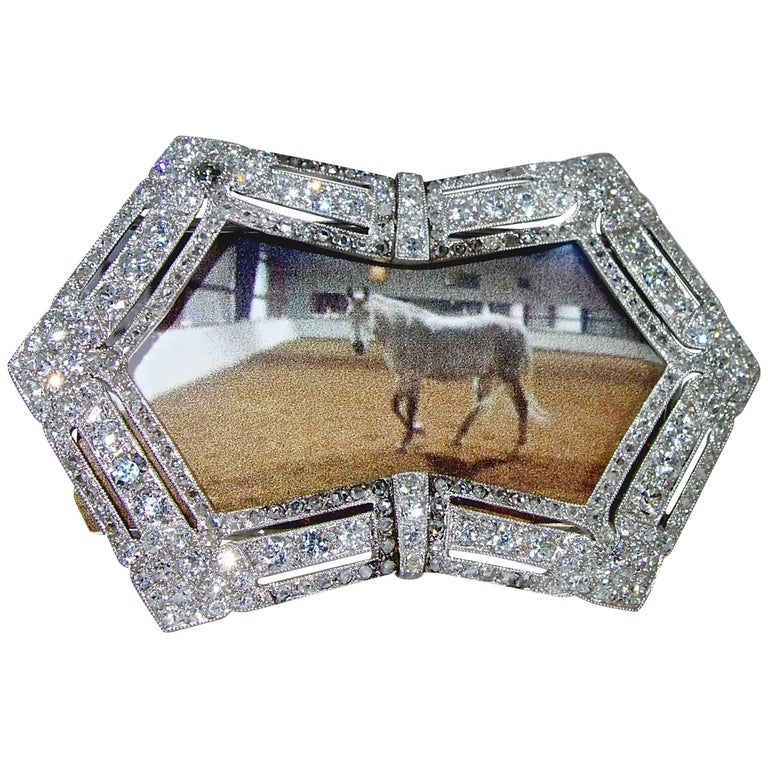 Antique diamond  frame for pictures is 2.5 inches by 1.5 inches.  It has approximately 5.5 cts of European, mine and rose cut diamonds.  The diamonds are white and bright.  A picture will fit within the back brackets.  this charming desk piece is
