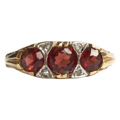 Edwardian Garnet and Diamond 9 Carat Gold Three-Stone Ring