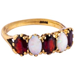 Edwardian Garnet and Opal 9 Carat Gold Five-Stone Ring