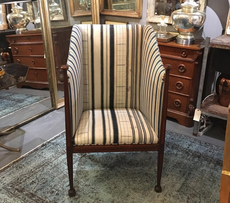 1910 very tall back Edwardian hall chair in blue and white 19th century linen homespun and early 20th century striped cotton ticking. Inlaid wood down front of chair, with carved wood caps and legs.