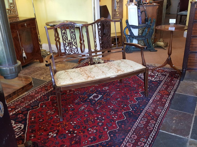 Edwardian inlaid and fret worked mahogany two-seat settee Measures: 46