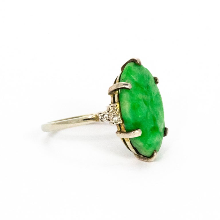 Stunning piece of Jade mounted beautifully on shoulders holding diamonds. Band and setting 18ct gold and platinum.  Ring Size: K 1/2 or 5 1/2
