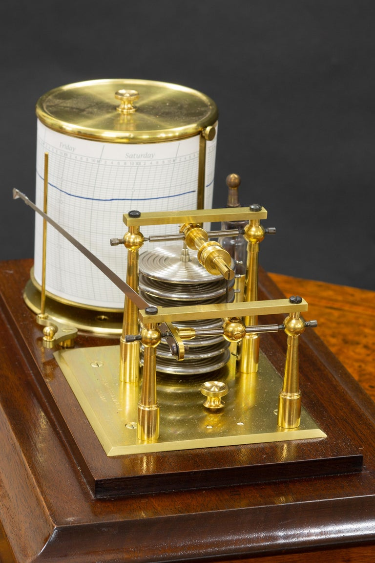 Negretti & Zambra    Fine Edwardian mahogany cased barograph with bevelled glass panels and central chart drawer.  Seven vacuum chambers linking the recording arm to the eight day revolving drum with lever escapement.  Original ink bottle