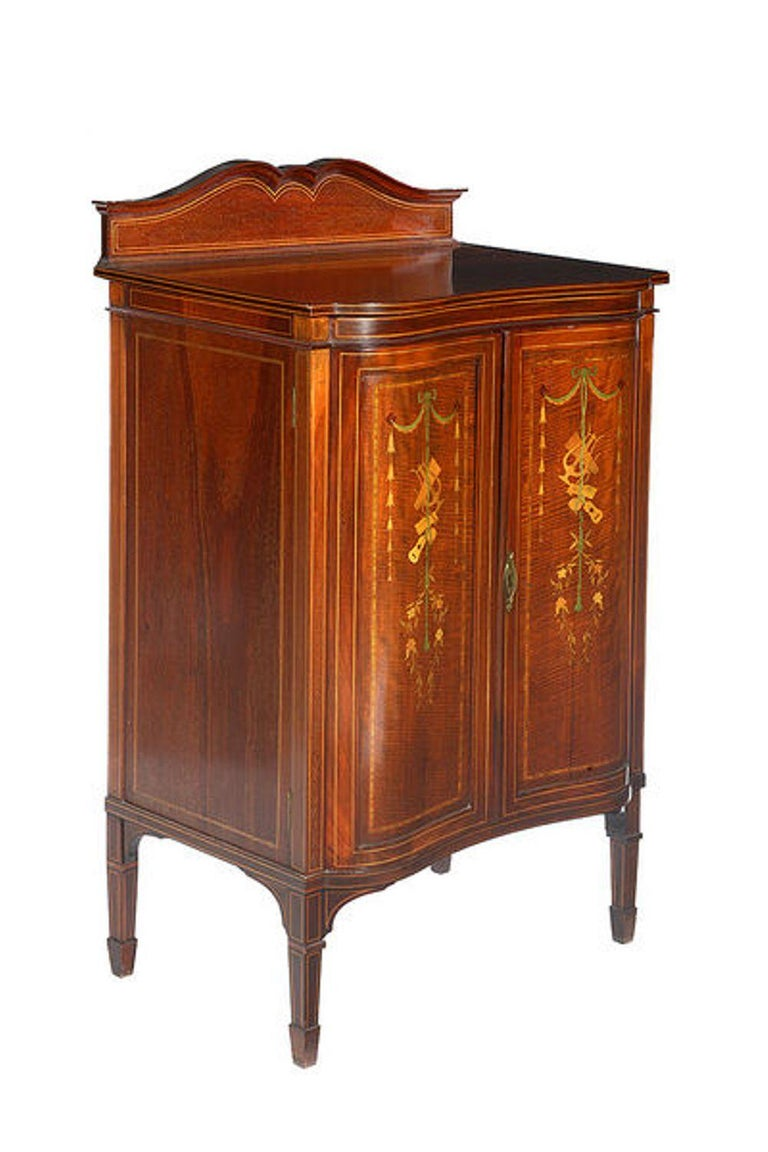 A mahogany and satinwood marquetry Edwardian two-door music cabinet.