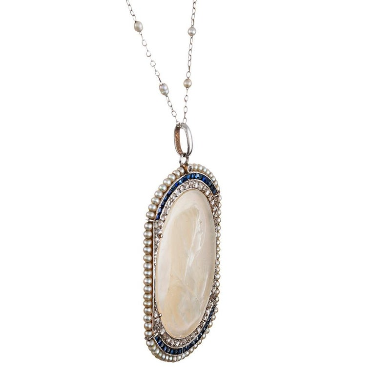 Round Cut Edwardian Mother of Pearl Madonna Pendant with Pearls, Sapphires and Diamonds For Sale