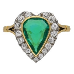 Edwardian Natural Colombian Emerald and Diamond Cluster Ring, circa 1905