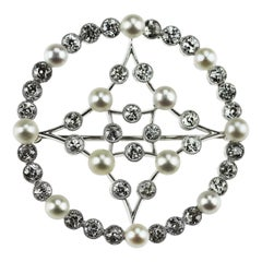 Edwardian Natural Pearl and Old European Diamonds Platinum Circular Brooch