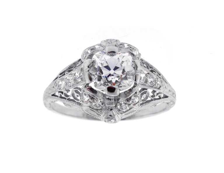 From Edwardian period and antique diamond engagement ring featuring a 1.14 carat Old mine cut diamond ♦ Metal: Platinum ♦ Old Mine cut diamond=1.14 carats  J color, VS1 clarity GIA report ♦ 16 Diamonds=.35 ♦ Circa 1920s ♦ Size 6, Resizable ♦