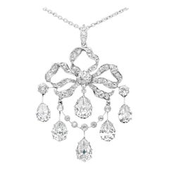 Edwardian Old Mine Diamond Pear Shapes Pendant Ribbon Bow Design, circa 1910