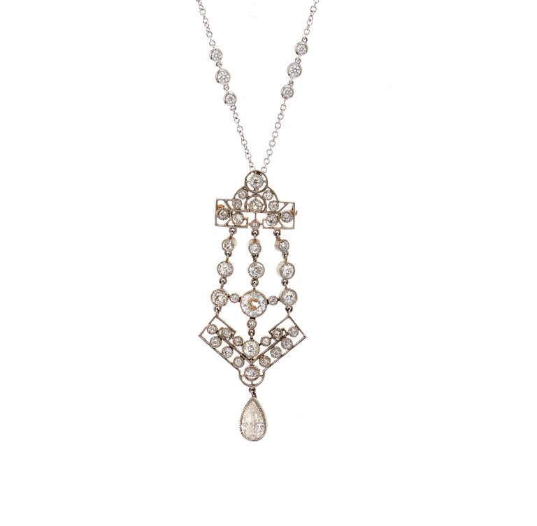 Edwardian openwork pendant set in Platinum backed in Gold with a Larger dangling Pear. Custom 17inch, 18k White Gold Diamond chain. Approximately 5.50 carats total. Diamonds vs1-i1 . Pendant 2-1/2 inches long; can be detached and worn as a hanging