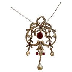 Edwardian Pendant with Chain / Brooch Platinum, Gold, Diamonds and Birma Ruby
