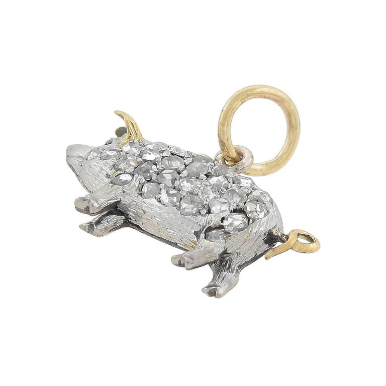 An absolutely lovely diamond pig charm pendant from the Edwardian (ca1910s) era! This wonderful piece is crafted of platinum-topped 15kt yellow gold and portrays a petite potbelly pig, whose body is encrusted with sparkling old Rose Cut diamonds.