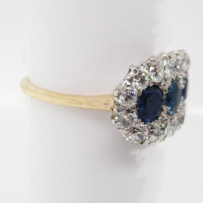 Edwardian Platinum 14 Karat Yellow Gold Diamond Sapphire Three-Stone Ring In Excellent Condition For Sale In Lexington, KY