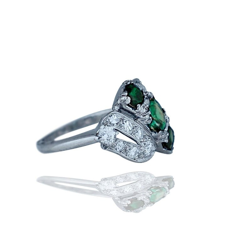 Retro Platinum .50 Ct. Diamond, 3 Green Stone  The setting is set with (16) round single cut diamonds graduating from 2.0-3.2 mm in diameter. The total weight of diamonds is estimated .50 carat.  Quality is SI1 clarity and G color, Size 6 and weight