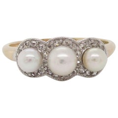 Edwardian Platinum over Gold Three-Stone Pearl Rose Cut Diamond Ring