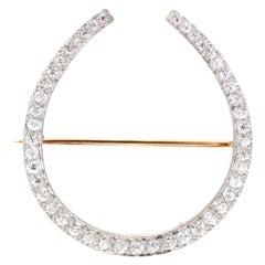 Edwardian Platinum Topped 18 Karat Yellow Gold Diamond Horseshoe Brooch