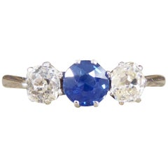 Edwardian Sapphire and Diamond Three-Stone Ring in Platinum
