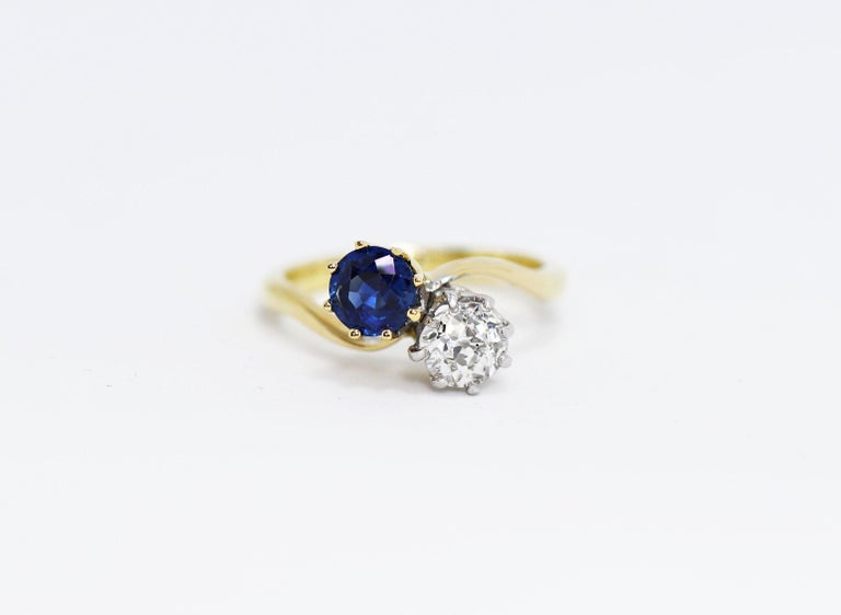 Edwardian Sapphire and Old Mine Cut Diamond Two-Stone Twist Engagement Ring For Sale 1