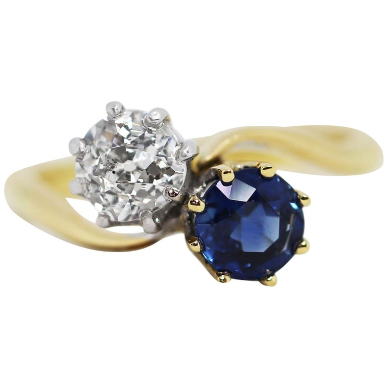 Edwardian Sapphire and Old Mine Cut Diamond Two-Stone Twist Engagement Ring For Sale