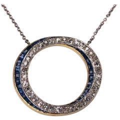 Edwardian Sapphire Diamond Circle Platinum and Gold Pendant Estate Fine Jewelry