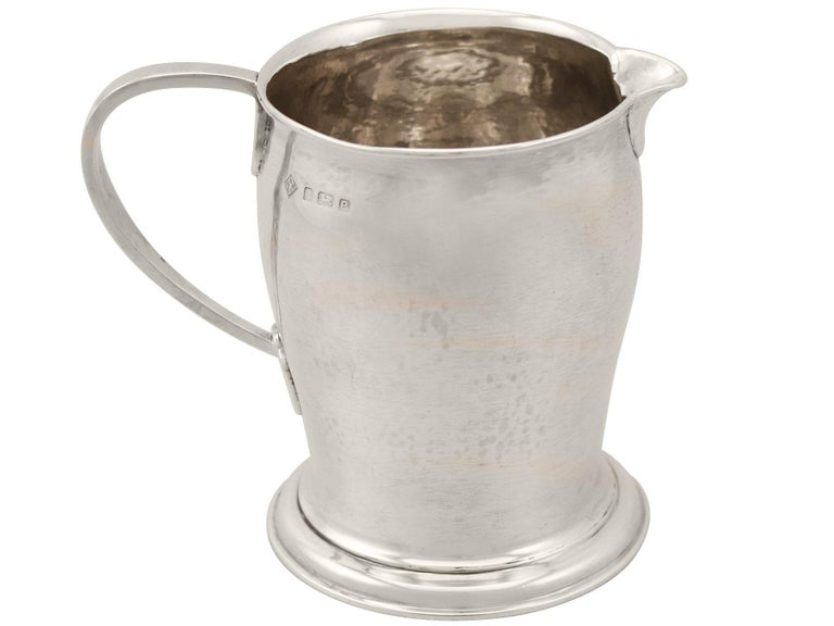 An exceptional, fine and impressive, large antique Edwardian English sterling silver Arts & Crafts cream jug made by Birmingham Guild of Handicraft; an addition to our range of collectable silverware.