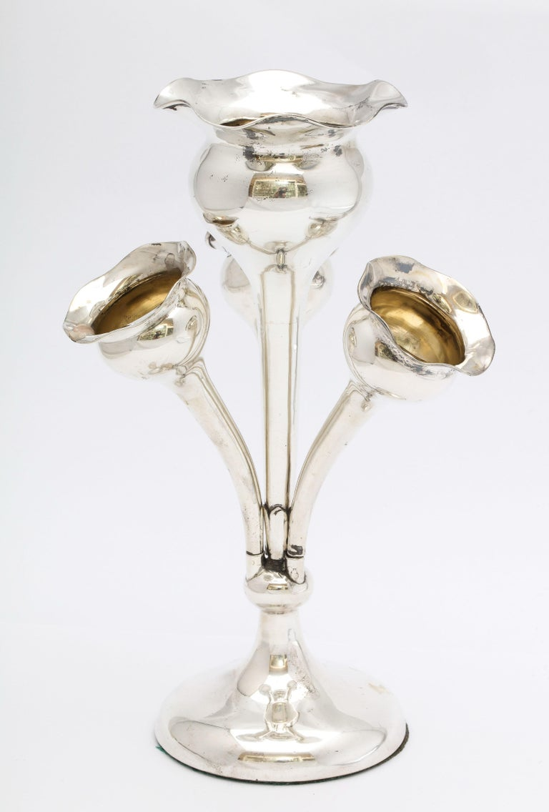 Lovely, Edwardian, sterling silver epergne, Birmingham, England, 1910. Three of the flower - form vases are removable. Measures 7 1/2 inches high (at highest point) x 5 1/4 inches across (from smaller vase to smaller vase) x 2 3/4 inches diameter