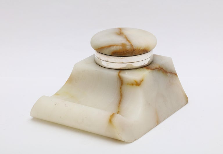Edwardian, sterling silver - mounted onyx inkwell, Birmingham, England, year-hallmarked for 1915. Measures 3 3/4 inches wide (at widest point) x 2 1/4 inches high x 4 inches deep. Some very minor chips on the bottom edge of the inkwell (see photos)