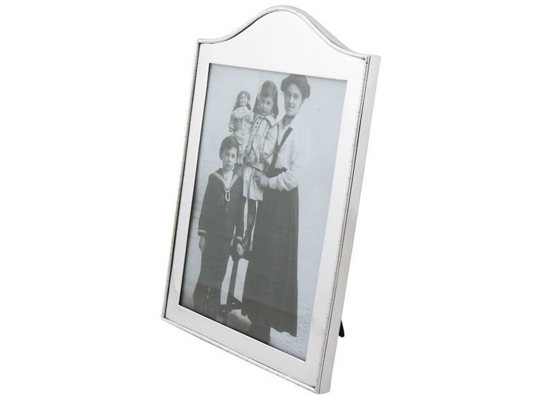 An exceptional, fine and impressive antique Edwardian English sterling silver photograph frame; an addition to our ornamental silverware collection.