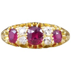Edwardian Vibrant Colored Ruby and Diamond Ring in 18 Carat Yellow Gold