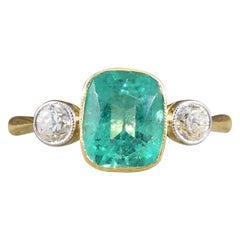 Edwardian Vibrant Emerald and Diamond Three-Stone Ring in 18 Carat Gold