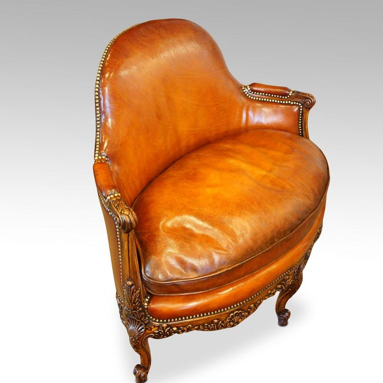 Edwardian walnut loveseat This walnut love seat was made circa 1910. The frame is beautifully carved, the carving being very crisp. It has a carved cabriole leg at the centre of the frame to the front and the rear,  The apron is carved with shell