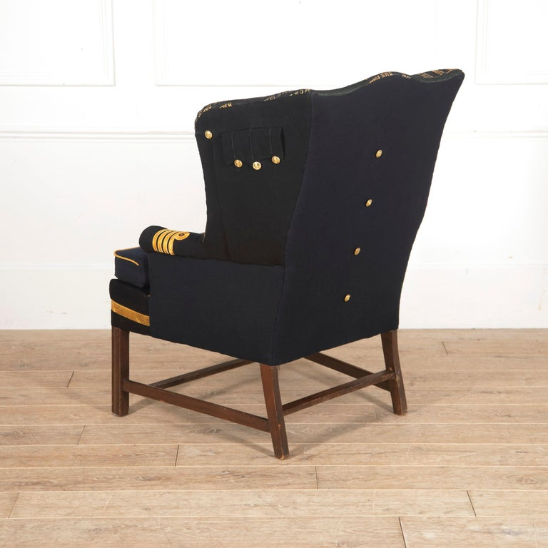 European Edwardian Wingback Armchair with Royal Navy Covering For Sale
