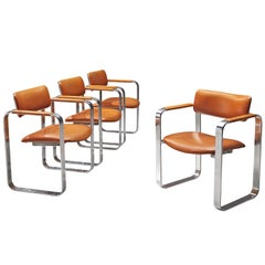 Eero Aarnio Set of Four Armchairs in Cognac Leather and Polished Aluminium